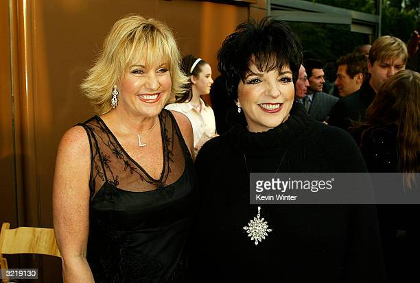 Singer Lorna Luft and her sister actress/singer Liza Minnelli arrive at Warner Home Video's 60th anniversary DVD release reception and screening of...