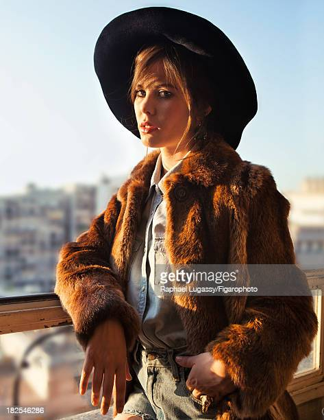 107463009 Singer Lou Lesage is photographed for Madame Figaro on July 19 2013 in Paris France Coat shirt shorts hat earrings ring CREDIT MUST READ...