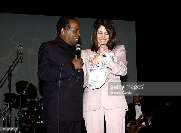 Singer Lou Rawls his wife Nina Malek Inman and baby Aiden Allen Rawls appear on stage at the inaugural event of the Lou Rawls Center For The...