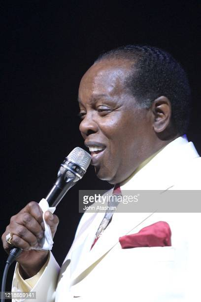 """Singer Lou Rawls is shown performing on stage during a """"live"""" concert appearance on September 15, 2002."""