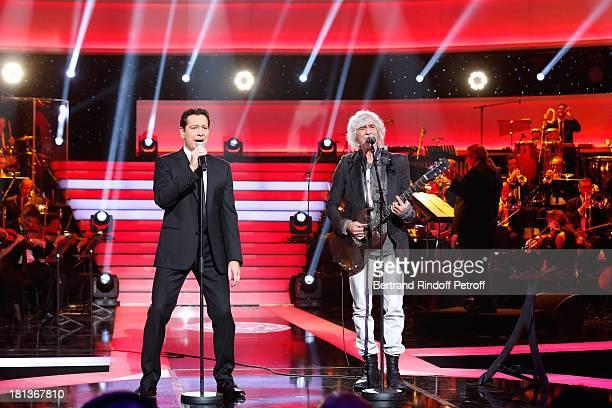 Singer Louis Bertignac (R) and humorist Laurent Gerra perform at 'Le Grand Show' by Laurent Gerra : Rehearsal at La Plaine Saint Denis on September 20, 2013 in Paris, France.