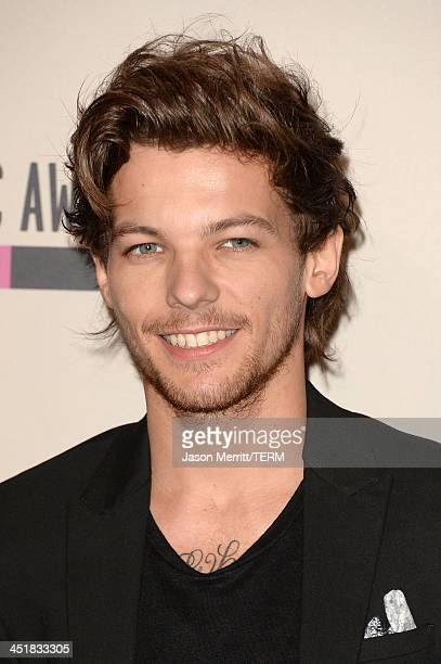 Singer Louis Tomlinson of One Direction winners of the Favorite Pop/Rock Album for 'Take Me Home' poses in the press room during the 2013 American...