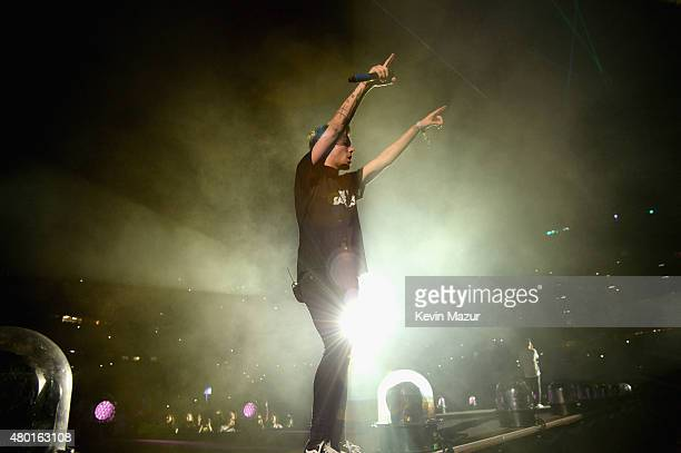 Singer Louis Tomlinson performs onstage during One Direction's 'On the Road Again' tour opener at Qualcomm Stadium on July 9 2015 in San Diego...