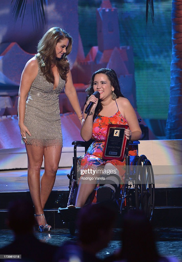 Singer Lucero (L) presents an award onstage during the Premios Juventud 2013 at Bank United Center on July 18, 2013 in Miami, Florida.