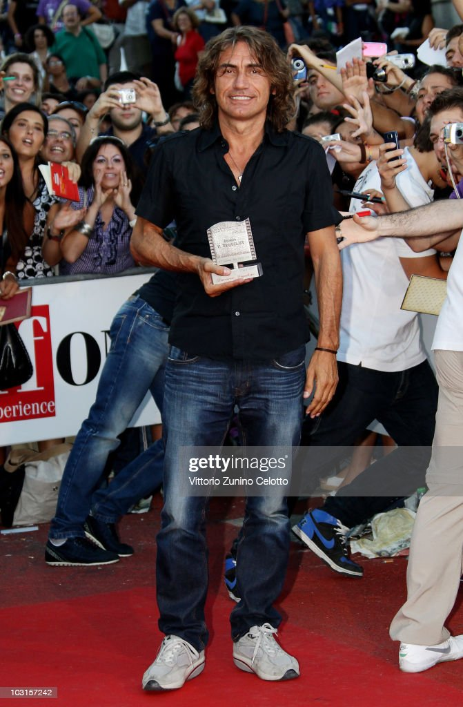 Singer Luciano Ligabue poses with the Francois Truffaut Award during Giffoni Experience 2010 on July 29, 2010 in Giffoni Valle Piana, Italy.