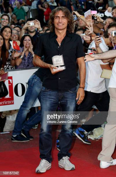 Singer Luciano Ligabue poses with the Francois Truffaut Award during Giffoni Experience 2010 on July 29 2010 in Giffoni Valle Piana Italy