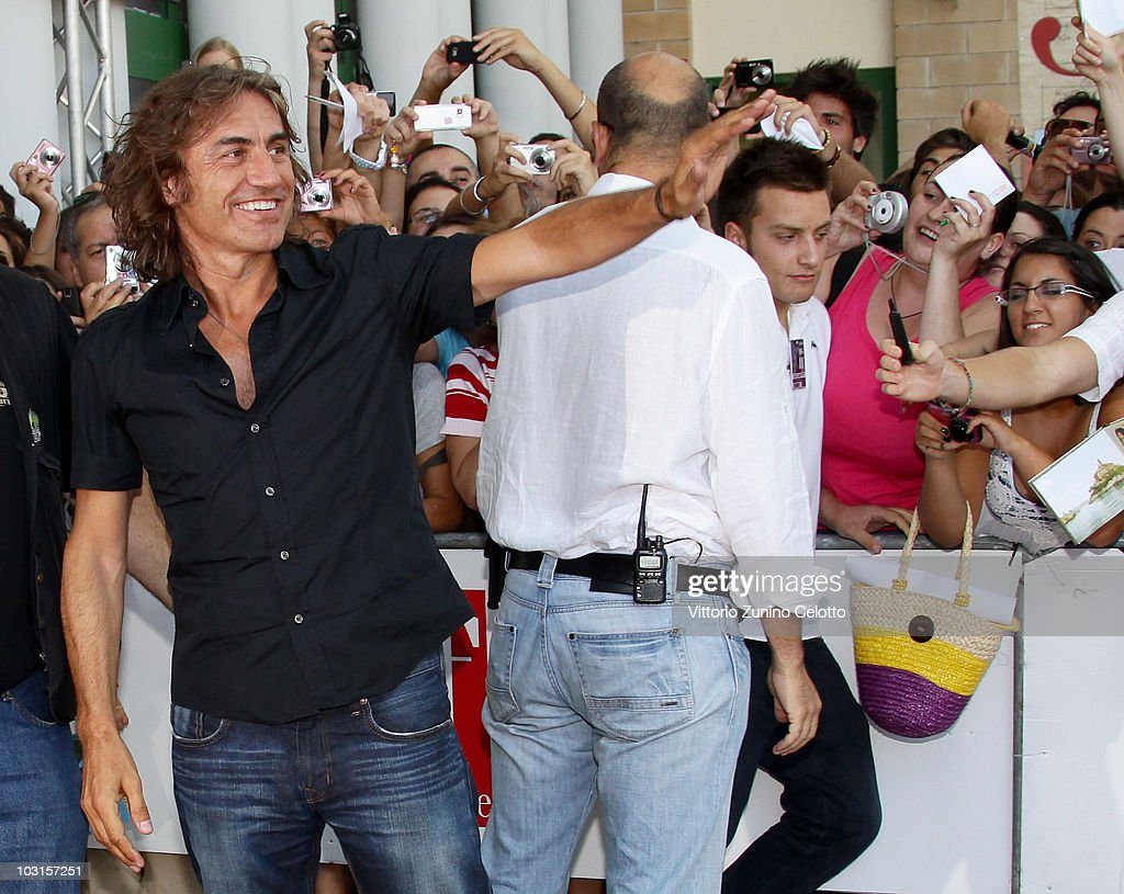 Singer Luciano Ligabue waves to the fans during Giffoni Experience 2010 on July 29, 2010 in Giffoni Valle Piana, Italy.