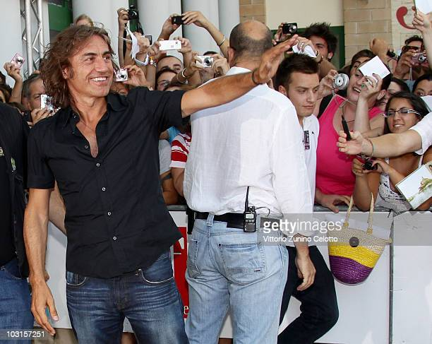 Singer Luciano Ligabue waves to the fans during Giffoni Experience 2010 on July 29 2010 in Giffoni Valle Piana Italy