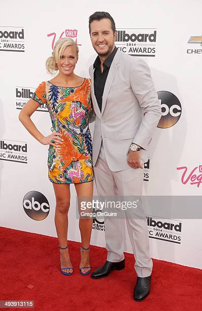 Singer Luke Bryan and Caroline Boyer arrive at the 2014 Billboard Music Awards at the MGM Grand Garden Arena on May 18 2014 in Las Vegas Nevada