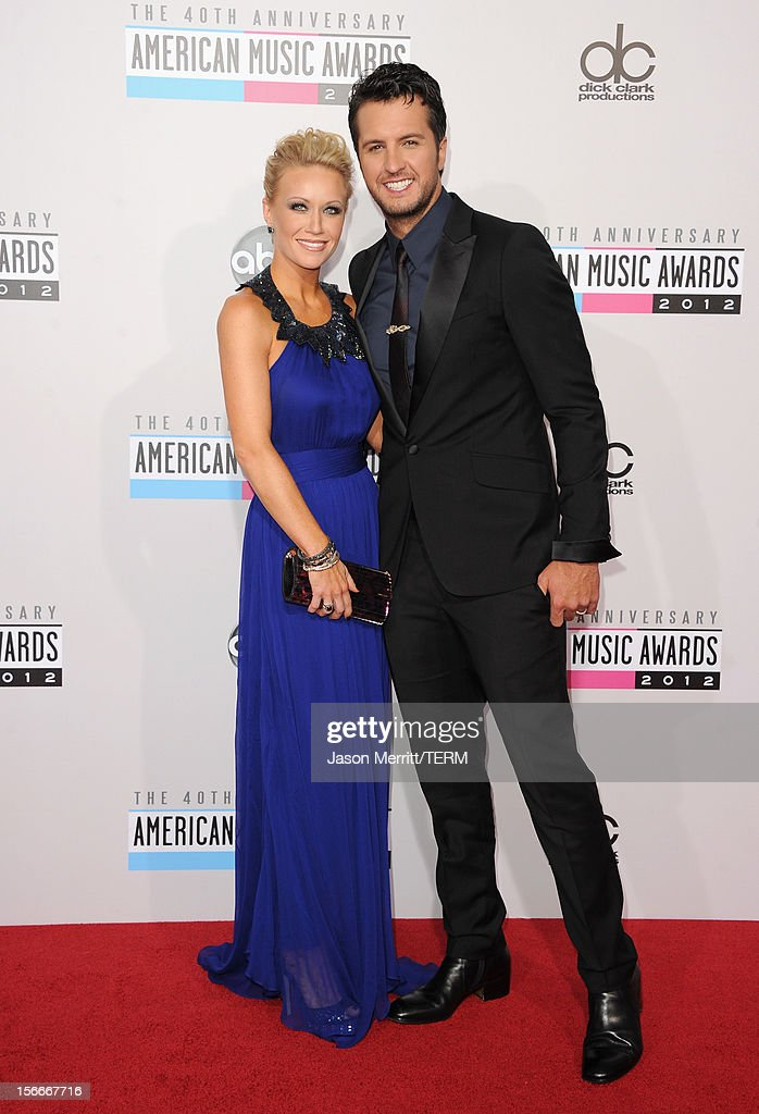 Singer Luke Bryan and wife Caroline attend the 40th American Music Awards held at Nokia Theatre L.A. Live on November 18, 2012 in Los Angeles, California.