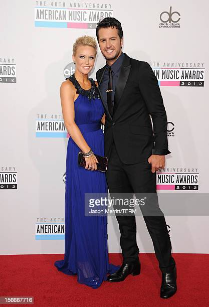Singer Luke Bryan and wife Caroline attend the 40th American Music Awards held at Nokia Theatre LA Live on November 18 2012 in Los Angeles California