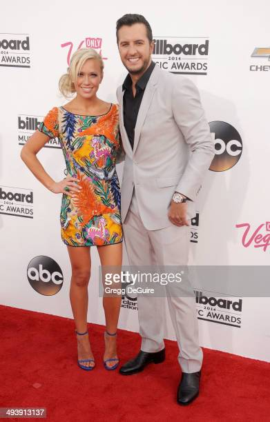 Singer Luke Bryan and wife Caroline Boyer arrive at the 2014 Billboard Music Awards at the MGM Grand Garden Arena on May 18 2014 in Las Vegas Nevada