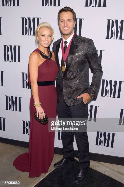 Singer Luke Bryan and wife Caroline Boyer attend the 61st annual BMI Country awards on November 5 2013 in Nashville Tennessee