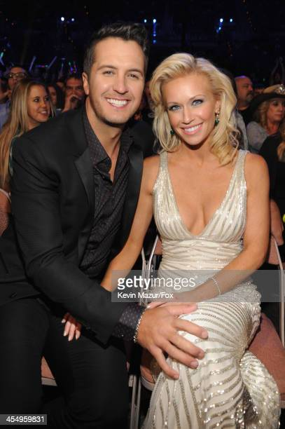 Singer Luke Bryan and wife Caroline Bryan attend the American Country Awards 2013 at the Mandalay Bay Events Center on December 10 2013 in Las Vegas...