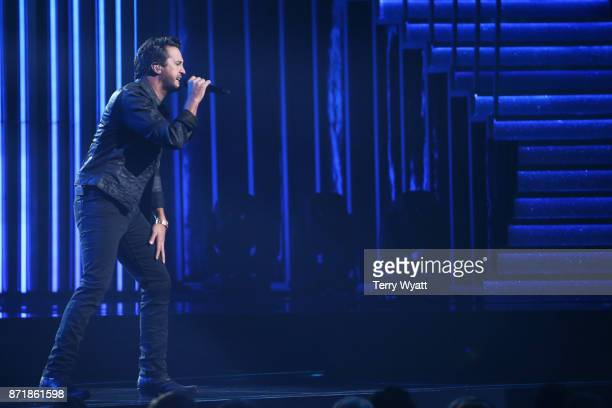 Singer Luke Bryan performs onstage during the 51st annual CMA Awards at the Bridgestone Arena on November 8 2017 in Nashville Tennessee