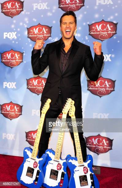Singer Luke Bryan poses in th press room during the American Country Awards 2013 at the Mandalay Bay Events Center on December 10, 2013 in Las Vegas,...