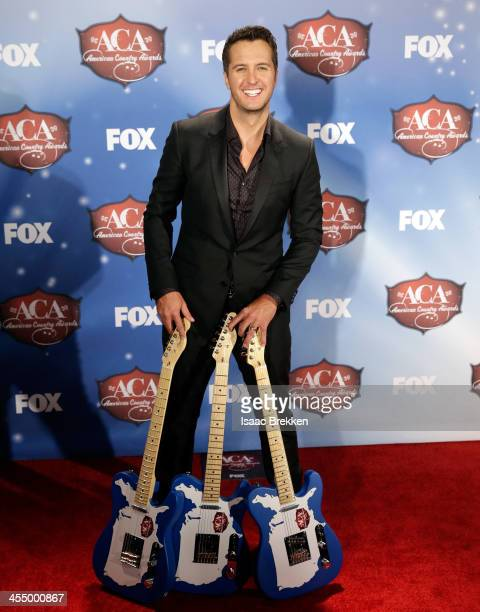 Singer Luke Bryan poses in the press room during the American Country Awards 2013 at the Mandalay Bay Events Center on December 10 2013 in Las Vegas...