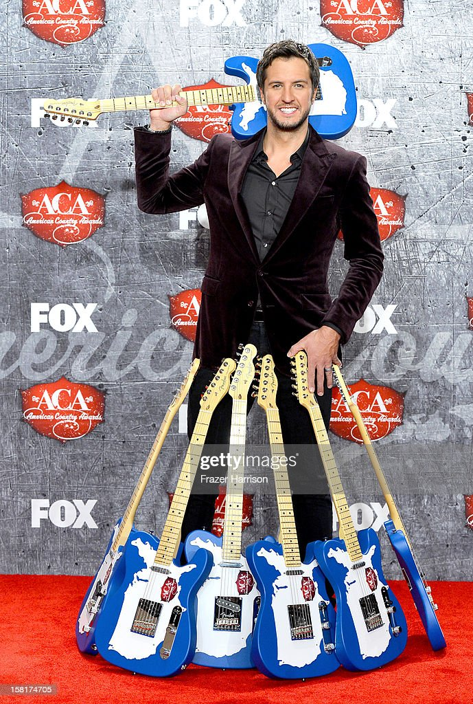 Singer Luke Bryan poses in the press room with multiple awards during the 2012 American Country Awards at the Mandalay Bay Events Center on December 10, 2012 in Las Vegas, Nevada.