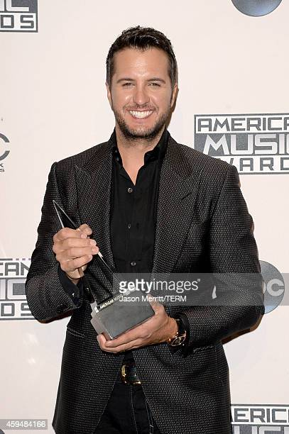 Singer Luke Bryan winner of Favorite Country Male Artist poses in the press room at the 2014 American Music Awards at Nokia Theatre LA Live on...