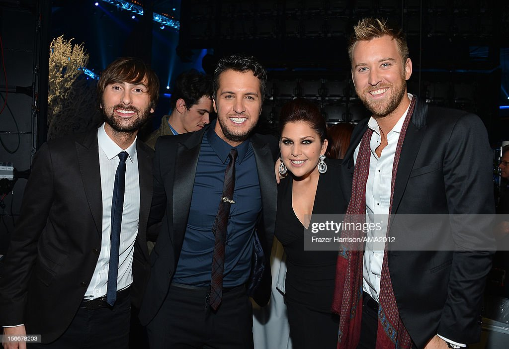 Singer Luke Bryan (2nd from L) with Lady Antebellum singers Dave Haywood, Hillary Scott and Charles Kelley at the 40th American Music Awards held at Nokia Theatre L.A. Live on November 18, 2012 in Los Angeles, California.