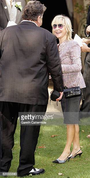 Singer Lulu and Actor Robbie Coltrane attend the wedding of musician Jools Holland and Christabel McEwen at St James's Church Cooling on August 30...