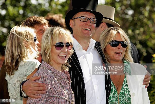 Singer Lulu comedian Adrian Edmonson and comedian Jennifer Saunders attend the wedding of musician Jools Holland and Christabel McEwen at St James's...