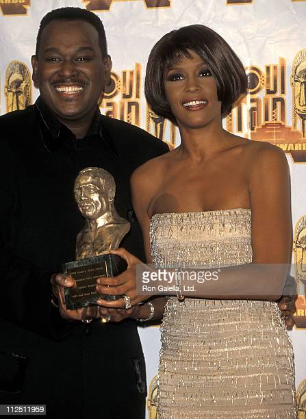 Singer Luther Vandross and singer Whitney Houston attend the 13th Annual Soul Train Music Awards on March 26 1999 at Shrine Auditorium in Los Angeles...