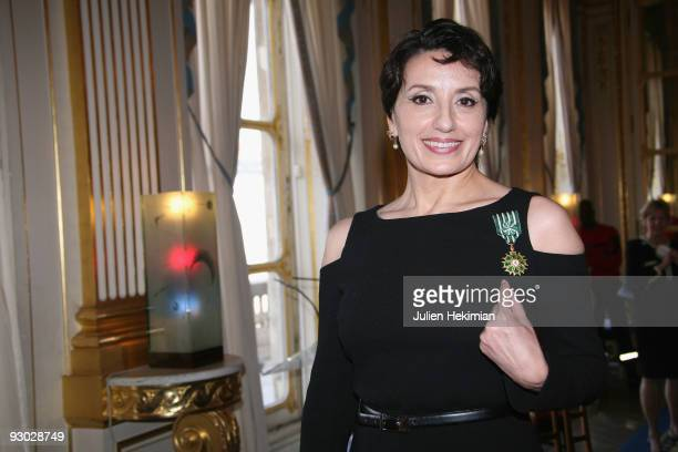 Singer Luz Casal poses after being decorated 'Officier dans l'Ordre des Arts et des Lettres' by French minister for Cultury Frederic Mitterrand at...
