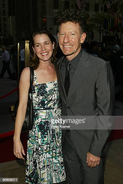 Singer Lyle Lovett and girlfriend April Kimble attend the Rockefeller Center Motorcycle Show Opening Night Bash May 19 2004 in New York City