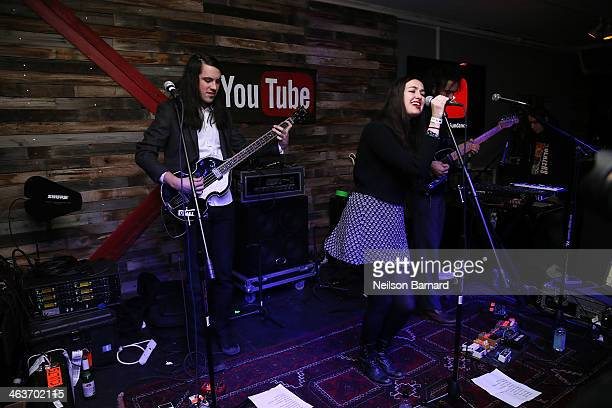 Singer Madeline Follin of Cults performs on stage at the YouTube on Main Street Party on January 18 2014 in Park City Utah