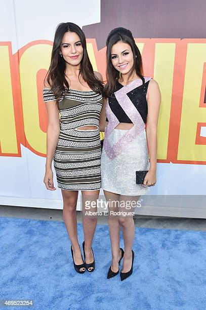 Singer Madison Reed and actress Victoria Justice attend The 2015 MTV Movie Awards at Nokia Theatre LA Live on April 12 2015 in Los Angeles California