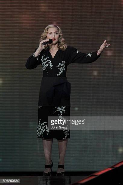 Singer Madona speaks during Oprah's Surprise Spectacular in Chicago May 17 2011