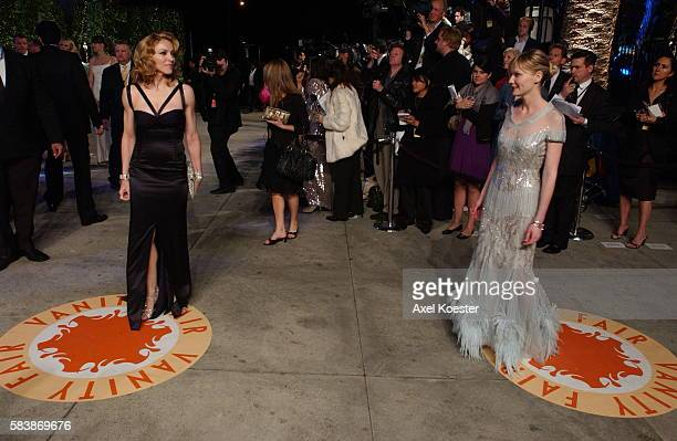 Singer Madonna and actress Kirsten Dunst arrive to the Vanity Fair Oscar® party at Morton's Restaurant in West Hollywood
