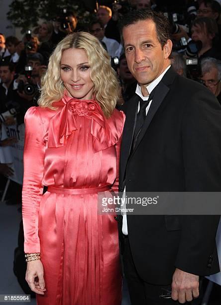 Singer Madonna and amFAR Chairman Kenneth Cole arrives at amfAR's Cinema Against AIDS 2008 benefit held at Le Moulin de Mougins during the 61st...