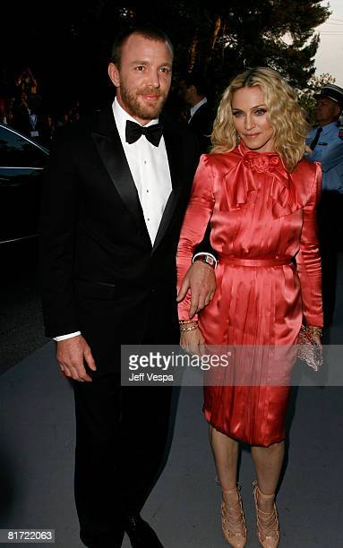 Singer Madonna and director Guy Richie arrives at amfAR's Cinema Against AIDS 2008 benefit held at Le Moulin de Mougins during the 61st International...