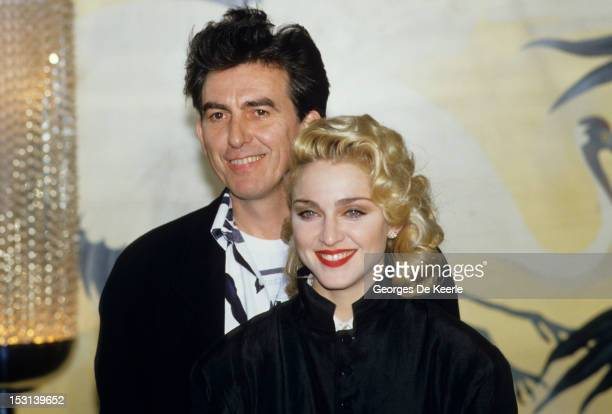 Singer Madonna and former Beatle George Harrison Beatles hold a press Conference for their film 'Shanghai Surprise' at the Kensington Roof Gardens in...