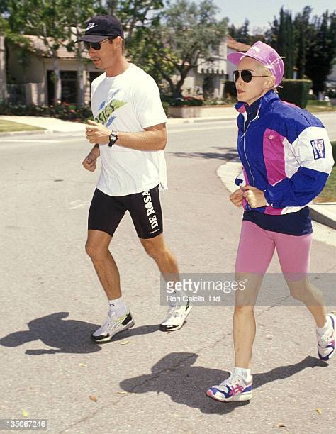 Singer Madonna and her trainer on May 10 1990 go for a jog near her home in Hollywood Hills California
