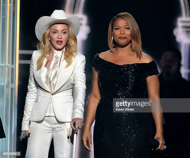 Singer Madonna and rapperactress Queen Latifah speak onstage during the 56th GRAMMY Awards at Staples Center on January 26 2014 in Los Angeles...