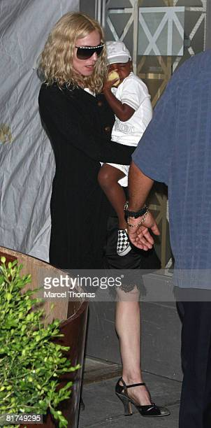 Singer Madonna and son David Banda attend Friday night prayers at the Kaballah Center in Manhattan on June 27 2008 in New York City
