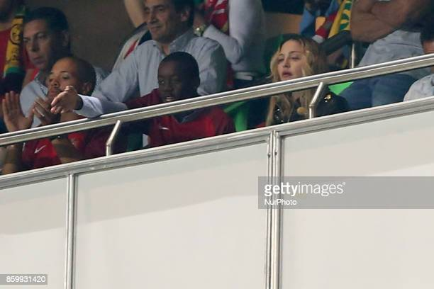 US singer Madonna attends the 2018 FIFA World Cup qualifying football match between Portugal and Switzerland at the Luz stadium in Lisbon Portugal on...