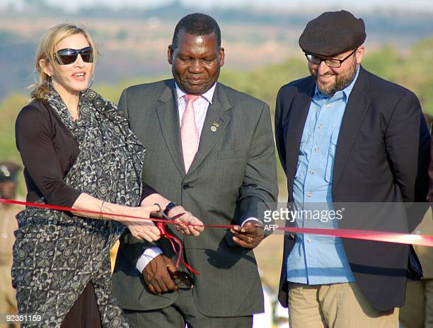 Singer Madonna cuts a ribbon next to Malawi�s Education Minister George Chiponda and the co-founder of Raising Malawi Girls Academy, Michael Berg...