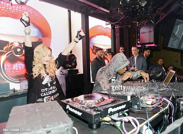Singer Madonna dances as DJ Lunice performs at Marquee Nightclub at The Cosmopolitan of Las Vegas as she hosts an after party for her Rebel Heart...