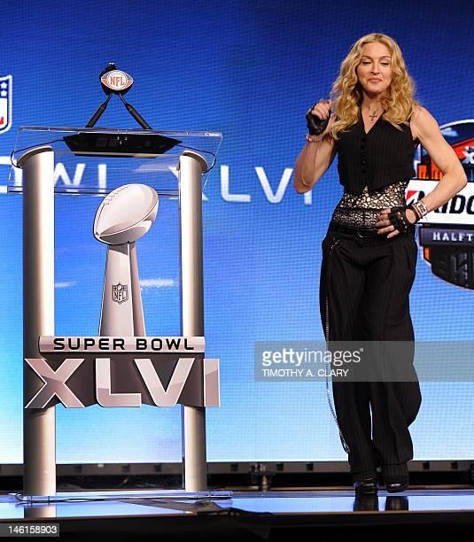 Singer Madonna dances during the Bridgestone Super Bowl XLVI Halftime Show Press Conference at the Super Bowl XLVI Media Center on February 2 2012 in...