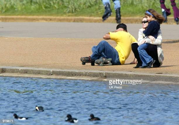 Singer Madonna embraces her daughter Lourdes during an outing in Hyde Park April 21 2002 in London England