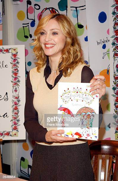Singer Madonna holds a copy of her book 'The English Roses' after reading to children and signing copies at the Barnes Noble store in Rockefeller...