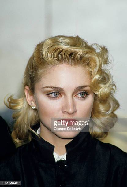 Singer Madonna holds a press Conference with former Beatle George Harrison for their film 'Shanghai Surprise' at the Kensington Roof Gardens in...
