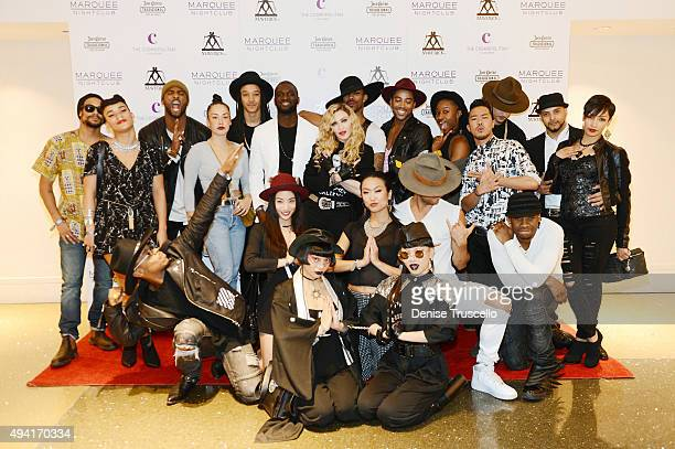 Singer Madonna is surrounded by her dancers as they arrive at the Marquee Nightclub at The Cosmopolitan of Las Vegas to host an after party for their...