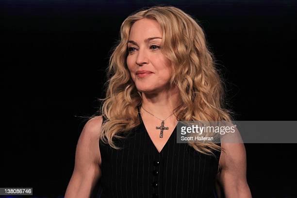 Singer Madonna looks on during a press conference for the Bridgestone Super Bowl XLVI halftime show at the Super Bowl XLVI Media Center in the J.W....