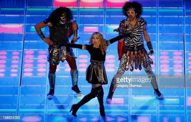 Singer Madonna performs alongside LMFAO during the Bridgestone Super Bowl XLVI Halftime Show at Lucas Oil Stadium on February 5, 2012 in...