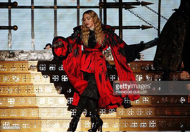US singer Madonna performs during a concert at the AccorHotels Arena in Paris on December 9 2015 / AFP / FRANCOIS GUILLOT